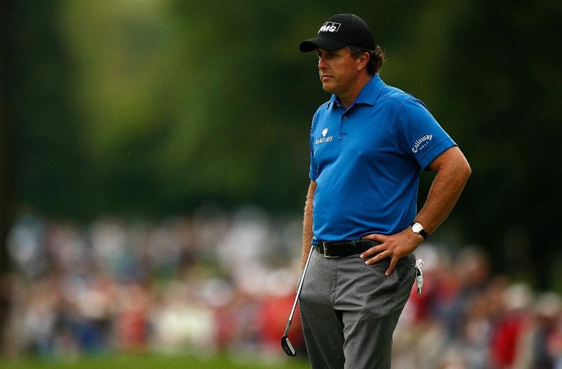 ST. LOUIS - SEPTEMBER 05: Phil Mickelson waits to putt on the 7th hole during the weather-delayed first round of the BMW Championship on September 5, 2008 at Bellerive Country Club in St. Louis, Missouri.  (Photo by Mike Ehrmann/Getty Images)