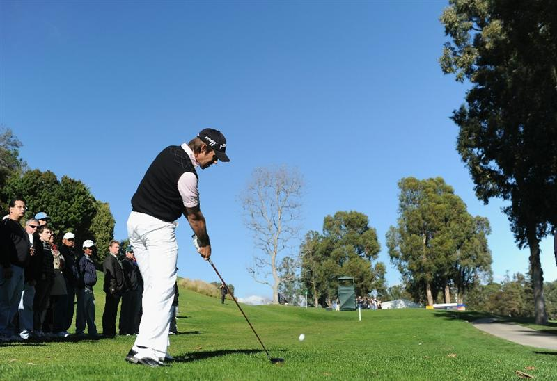 PACIFIC PALISADES, CA - FEBRUARY 20:  Aaron Baddeley of Australia plays his approach shot on the 17th hole during the final round of the Northern Trust Open at Riviera Country Club on February 20, 2011 in Pacific Palisades, California.  (Photo by Stuart Franklin/Getty Images)