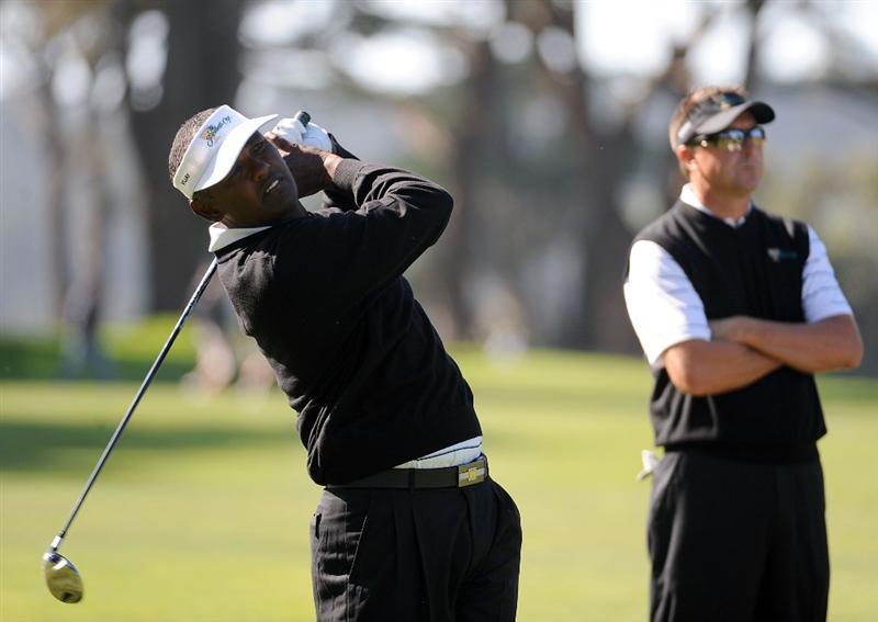 SAN FRANCISCO - OCTOBER 07:  Vijay Singh (L) and Robert Allenby of the International Team watch a shot during a practice round prior to the start of The Presidents Cup at Harding Park Golf Course on October 7, 2009 in San Francisco, California.  (Photo by Harry How/Getty Images)