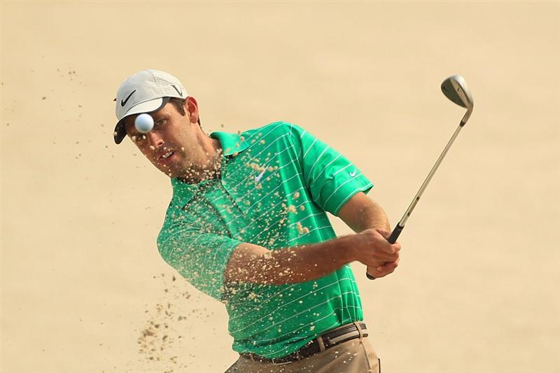 PONTE VEDRA BEACH, FL - MAY 11:  Charl Schwartzel of South Africa hits from a bunker during a practice round prior to the start of THE PLAYERS Championship held at THE PLAYERS Stadium course at TPC Sawgrass on May 11, 2011 in Ponte Vedra Beach, Florida.  (Photo by Streeter Lecka/Getty Images)