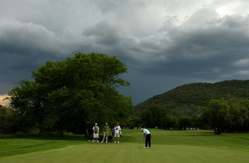 SUN CITY, SOUTH AFRICA - DECEMBER 05:  Lee Westwood of England putts on the 11th green as storm clouds gather above the course during the second round of the Nedbank Golf Challenge at the Gary Player Country Club on December 5, 2008 in Sun City, South Africa.  (Photo by Richard Heathcote/Getty Images)