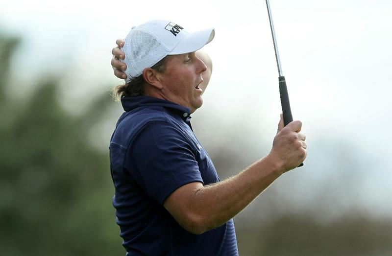 LA JOLLA, CA - JANUARY 30:  Phil Mickelson reacts after just missing an eagle putt attempt on the 13th hole during the final round of the Farmers Insurance Open at Torrey Pines South Course on January 30, 2011 in La Jolla, California.  (Photo by Stephen Dunn/Getty Images)