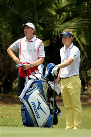 PONTE VEDRA BEACH, FL - MAY 13:  Luke Donald of England (R) and caddie John McLaren (L) wait on the second fairway during the second round of THE PLAYERS Championship held at THE PLAYERS Stadium course at TPC Sawgrass on May 13, 2011 in Ponte Vedra Beach, Florida.  (Photo by Mike Ehrmann/Getty Images)
