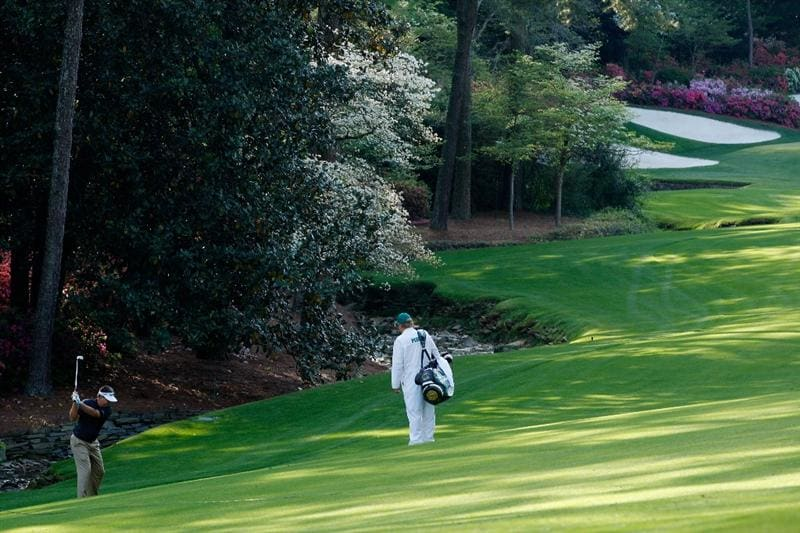 AUGUSTA, GA - APRIL 11:  Kenny Perry hits his second shot on the 13th hole as his caddie Fred Sanders looks on during the third round of the 2009 Masters Tournament at Augusta National Golf Club on April 11, 2009 in Augusta, Georgia.  (Photo by Jamie Squire/Getty Images)
