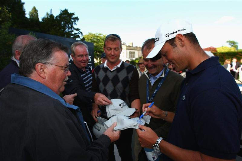 LUSS, UNITED KINGDOM - JULY 12:   Martin Kaymer of Germany signs autographs for fans following his victory at the end of the Final Round of The Barclays Scottish Open at Loch Lomond Golf Club on July 12, 2009 in Luss, Scotland. (Photo by Richard Heathcote/Getty Images)