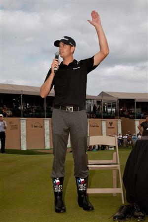 SAN ANTONIO, TX - APRIL 17: Brendan Steele waves to the gallery after donning  a pair of cowboy boots presented to the winner of the Valero Texas Open at the AT&T Oaks Course at TPC San Antonio on April 17, 2011 in San Antonio, Texas. (Photo by Darren Carroll/Getty Images)