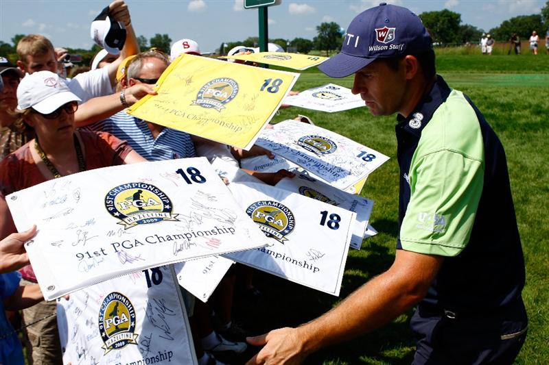 CHASKA, MN - AUGUST 12:  Padraig Harrington of Ireland signs autographs for fans during the third preview day of the 91st PGA Championship at Hazeltine National Golf Club on August 12, 2009 in Chaska, Minnesota.  (Photo by Scott Halleran/Getty Images)