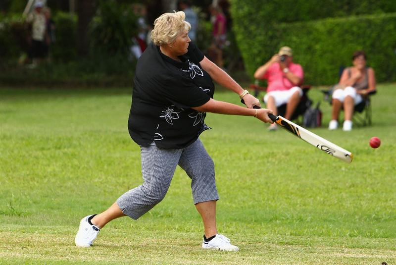 GOLD COAST, AUSTRALIA - MARCH 07:  Laura Davies of England plays cricket with fellow players following round four of the 2010 ANZ Ladies Masters at Royal Pines Resort on March 7, 2010 in Gold Coast, Australia.  (Photo by Ryan Pierse/Getty Images)