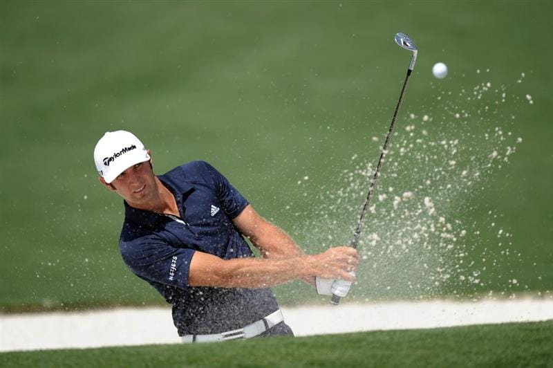 AUGUSTA, GA - APRIL 08:  Dustin Johnson hits a bunker shot on the second hole during the second round of the 2011 Masters Tournament at Augusta National Golf Club on April 8, 2011 in Augusta, Georgia.  (Photo by Harry How/Getty Images)