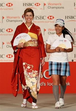 SINGAPORE - FEBRUARY 22:  Paula Creamer of the USA wears a traditional Japanese dress alongside Ai Miyazato of Japan during a photocall at the Fairmont Hotel prior to the start of the HSBC Women's Champions at the Tanah Merah Country Club on February 22, 2011 in Singapore.  (Photo by Andrew Redington/Getty Images)