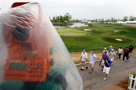 AVONDALE, LA - MARCH 29:  Spectators walk past the 18th green while waiting for a weather delay to clear during the Third Round of the Zurich Classic of New Orleans on March 29, 2008  at TPC Louisiana in Avondale, Louisiana.  (Photo by Chris Graythen/Getty Images)