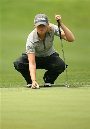 WILLIAMSBURG, VA : Stacy Lewis lines up her birdie putt on the 18th hole during the first round of the Michelob Ultra Open at Kingsmill Resort on May 7, 2009 in Williamsburg, Va. (Photo by Hunter Martin/Getty Images)