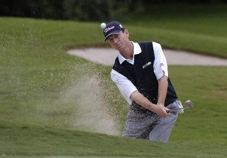 Brad Faxon blasts from the sand on the 12th hole during first-round competition March 3, 2005  at the Ford Championship at Doral in Miami.