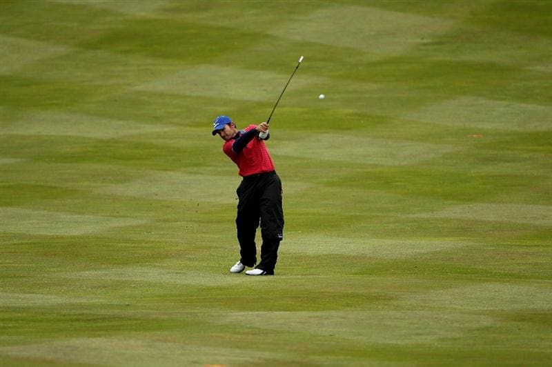 VIRGINIA WATER, ENGLAND - MAY 26:  Ignacio Garrido of Spain plays an approach shot on the fourth hole during the first round of the BMW PGA Championship at Wentworth Club on May 26, 2011 in Virginia Water, England.  (Photo by Andrew Redington/Getty Images)