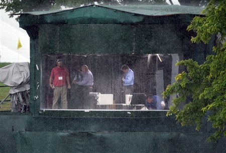 BLOOMFIELD HILLS, MI - AUGUST 09: Butch Harmon (C) and David Livington (R) escape from the rain in the Sky Television booth during round three of the 90th PGA Championship at Oakland Hills Country Club on August 9, 2008 in Bloomfield Township, Michigan.  (Photo by David Cannon/Getty Images)