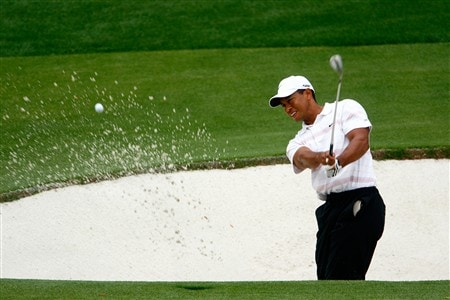 AUGUSTA, GA - APRIL 12:  Tiger Woods plays a bunker shot on the 15th hole during the third round of the 2008 Masters Tournament at Augusta National Golf Club on April 12, 2008 in Augusta, Georgia.  (Photo by Jamie Squire/Getty Images)