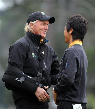 SAN FRANCISCO - OCTOBER 11:  Captain Greg Norman of the International Team congratulates Ryo Ishikawa for his 2 and 1 win over Kenny Perry on the 17th green during the Day Four Singles Matches of The Presidents Cup at Harding Park Golf Course on October 11, 2009 in San Francisco, California.  (Photo by Harry How/Getty Images)
