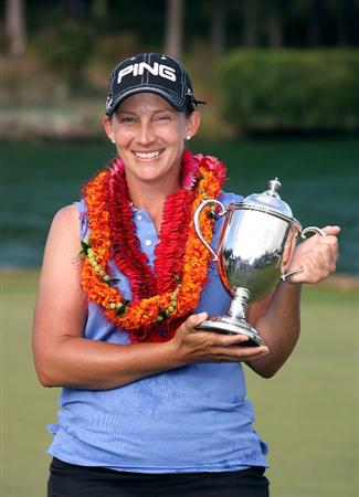 KAHUKU, HI - FEBRUARY 14:  Angela Stanford holds the winner's trophy after winning the SBS Open on February 14, 2009 at the Turtle Bay Resort in Kahuku, Hawaii.  (Photo by Andy Lyons/Getty Images)