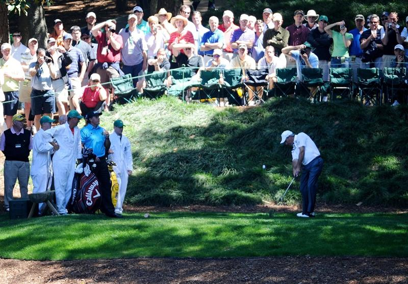 AUGUSTA, GA - APRIL 06:  Fred Couples hits a shot as a gallery of fans looks on during the Par 3 Contest prior to the 2011 Masters Tournament at Augusta National Golf Club on April 6, 2011 in Augusta, Georgia.  (Photo by Harry How/Getty Images)