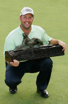 MALELANE, SOUTH AFRICA - DECEMBER 09:  John Bickerton of England poses with the trophy after winning The Alfred Dunhill Championship at The Leopard Creek Country Club on December 9, 2007 in Malelane, South Africa.  (Photo by Warren Little/Getty Images)