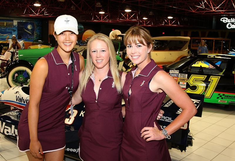 SUGAR GROVE, IL - AUGUST 17:  (L-R), Michelle Wie, Morgan Pressel and Paula Creamer of the U.S. Solheim team pose inside the car museum on the grounds of Rich Harvest Farms, host site of the 2009 Solheim Cup on August 17, 2009 in Sugar Grove, Illinois.  (Photo by David Cannon/Getty Images)
