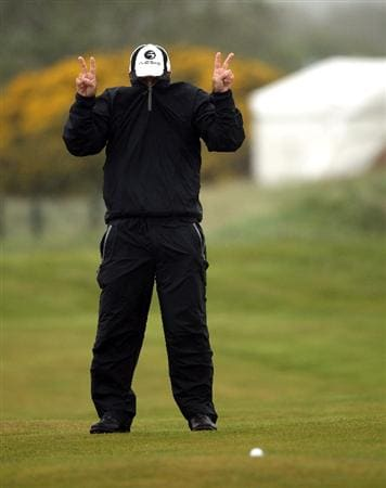BALTRAY, IRELAND - MAY 16:  Thomas Levet of France fools around in the high winds and rain on the second hole during the third round of The 3 Irish Open at County Louth Golf Club on May 16, 2009 in Baltray, Ireland.  (Photo by Andrew Redington/Getty Images)