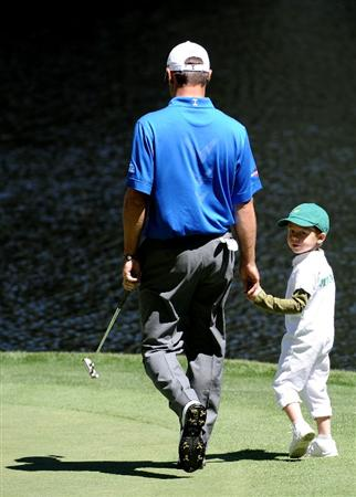 AUGUSTA, GA - APRIL 06:  Trevor Immelman of South Africa walks with his son Jacob on a green during the Par 3 Contest prior to the 2011 Masters Tournament at Augusta National Golf Club on April 6, 2011 in Augusta, Georgia.  (Photo by Harry How/Getty Images)