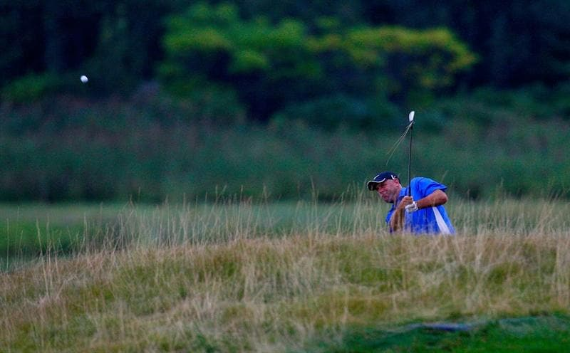 JERSEY CITY, NJ - AUGUST 28:  Stewart Cink plays his second shot from the rough on the 18th hole during round two of The Barclays on August 28, 2009 at Liberty National in Jersey City, New Jersey.  (Photo by Kevin C. Cox/Getty Images)