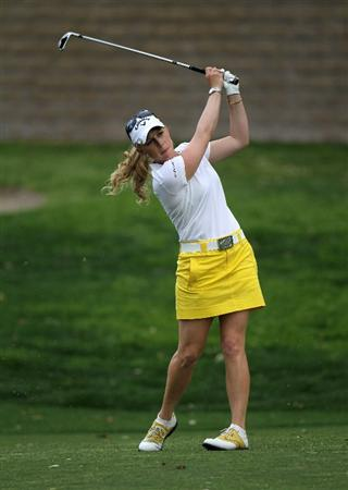 RANCHO MIRAGE, CA - APRIL 02:  Morgan Pressel hits her second shot on the 15th hole during the third round of the Kraft Nabisco Championship at Mission Hills Country Club on April 2, 2011 in Rancho Mirage, California.  (Photo by Stephen Dunn/Getty Images)
