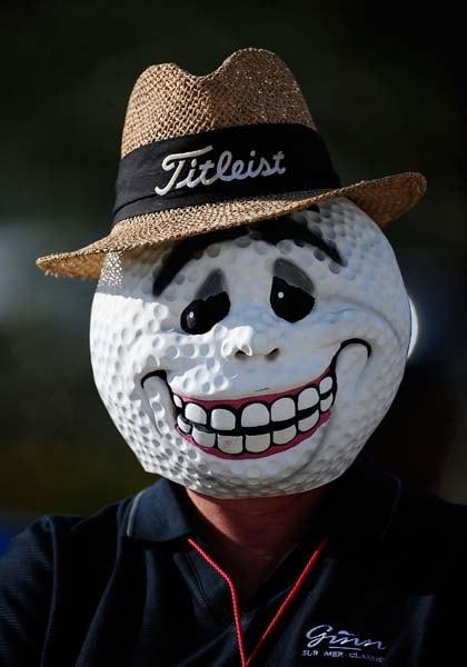Volunteer in a nice golf ball mask