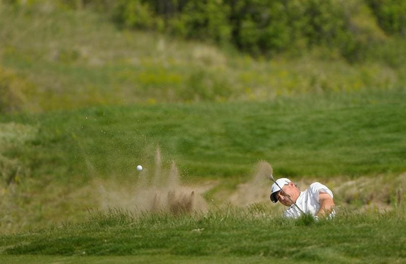 PARKER, CO - MAY 28: John Cook hits out of the greenside bunker on the 7th hole during the second round of the Senior PGA Championship at the Colorado Golf Club on May 28, 2010 in Parker, Colorado.  (Photo by Marc Feldman/Getty Images)