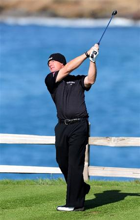 PEBBLE BEACH, CA - FEBRUARY 14:  Alex Cejka of Germany plays his tee shot on the seventh hole during the final round of the AT&T Pebble Beach National Pro-Am at Pebble Beach Golf Links on February 14, 2010 in Pebble Beach, California.  (Photo by Stuart Franklin/Getty Images)
