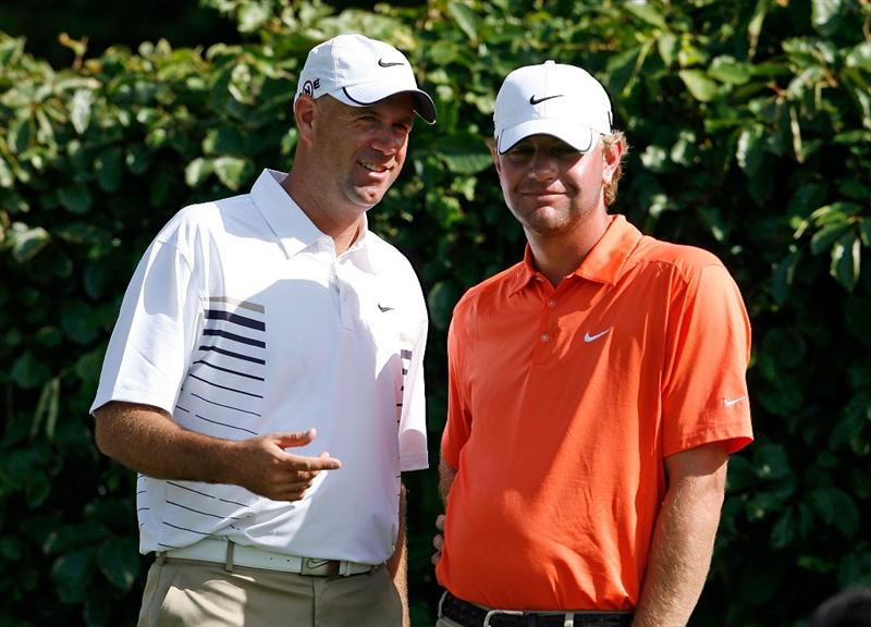 SOUTHAMPTON, BERMUDA - OCTOBER 21:  Stewart Cink the 2009 Brittish Open champion and Lucas Glover the 2009 U.S. Open champion, talk on the  tee of the 3rd hole during the final round of the PGA Grand Slam of Golf on October 21, 2009 at Port Royal Golf Course in Southampton, Bermuda.  (Photo by Andy Lyons/Getty Images)