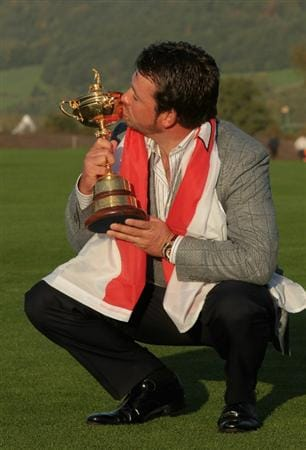 NEWPORT, WALES - OCTOBER 04:  European Team member Graeme McDowell poses with the Ryder Cup following Europe's 14.5 to 13.5 victory over the USA at the 2010 Ryder Cup at the Celtic Manor Resort on October 4, 2010 in Newport, Wales.  (Photo by David Cannon/Getty Images)