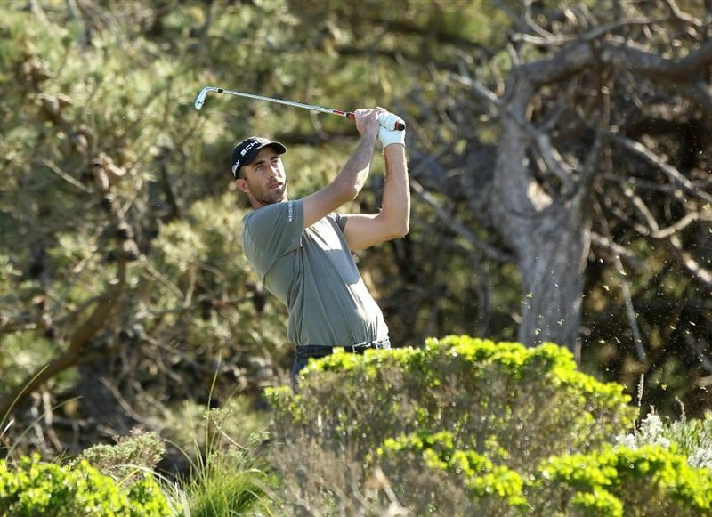PEBBLE BEACH, CA - FEBRUARY 10:  Geoff Ogilvy of Australia tees off on the third hole at the Spyglass Hill Golf Course during Round One of the AT&T Pebble Beach National Pro-Am on February 10, 2011 in Pebble Beach, California.  (Photo by Ezra Shaw/Getty Images)