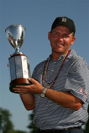 AVONDALE, LA - APRIL 25:  Jason Bohn poses with the trophy following his victory in the Zurich Classic at TPC Louisiana on April 25, 2010 in Avondale, Louisiana.  (Photo by Chris Trotman/Getty Images)