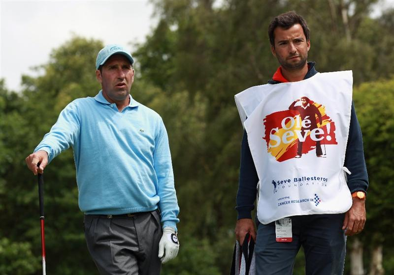 VIRGINIA WATER, ENGLAND - MAY 23:  Jose Maria Olazabal of Spain with his caddie during the 'Ole Seve' Pro-Am in aid of the Seve Ballesteros Foundation at Wentworth Club on May 23, 2011 in Virginia Water, England.  (Photo by Andrew Redington/Getty Images)
