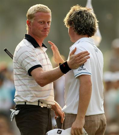 HONG KONG - NOVEMBER 21:  Simon Dyson of England and Rory McIlroy (R) of Northern Ireland acknowledge each other on the 18th hole during day four of the UBS Hong Kong Open at The Hong Kong Golf Club on November 21, 2010 in Hong Kong.  (Photo by Ian Walton/Getty Images)