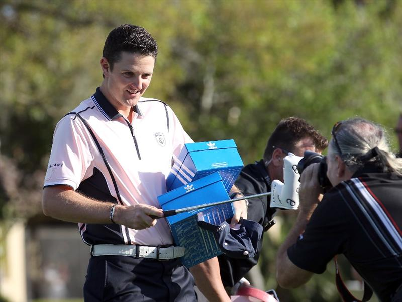 ORLANDO, FL - MARCH 14:  Justin Rose of England points at a photographer prior to the first day of the Tavistock Cup at Isleworth Country Club on March 14, 2011 in Orlando, Florida.  (Photo by Sam Greenwood/Getty Images)