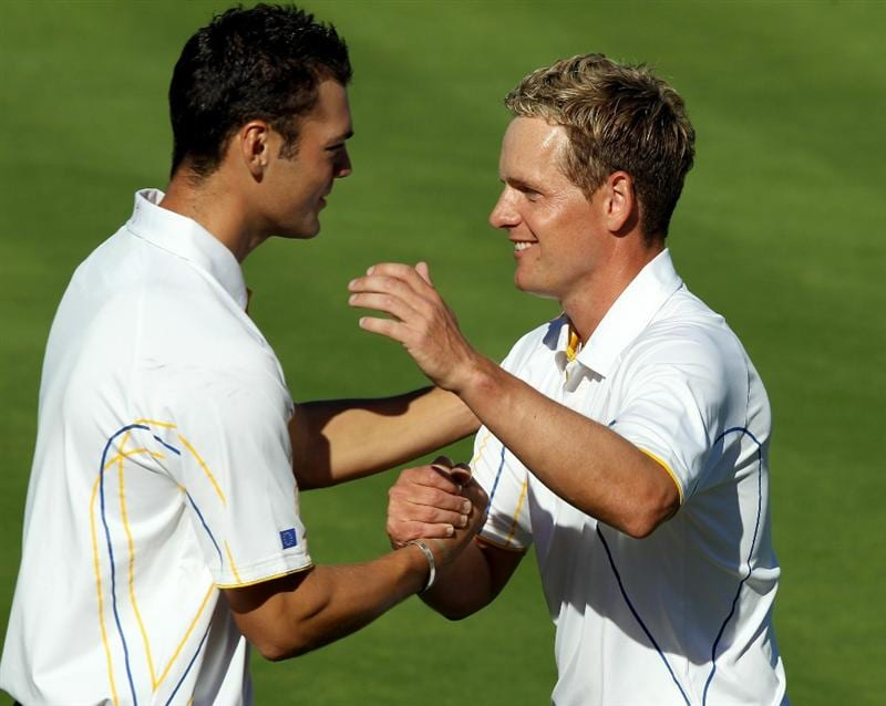 NEWPORT, WALES - OCTOBER 04:  Luke Donald of Europe is congratulated by Martin Kaymer (L) after he won his match on the 18th green in the singles matches during the 2010 Ryder Cup at the Celtic Manor Resort on October 4, 2010 in Newport, Wales.  (Photo by Ross Kinnaird/Getty Images)