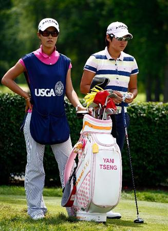 BETHLEHEM, PA - JULY 10:  Yani Tseng of Taiwan waits on the 15th hole alongside her caddie during the second round of the 2009 U.S. Women's Open at the Saucon Valley Country Club on July 10, 2009 in Bethlehem, Pennsylvania.  (Photo by Scott Halleran/Getty Images)