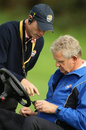 NEWPORT, WALES - SEPTEMBER 30:  Europe Team Captain Colin Montgomerie gets some advice on using his radio during a practice round prior to the 2010 Ryder Cup at the Celtic Manor Resort on September 30, 2010 in Newport, Wales.  (Photo by Ross Kinnaird/Getty Images)