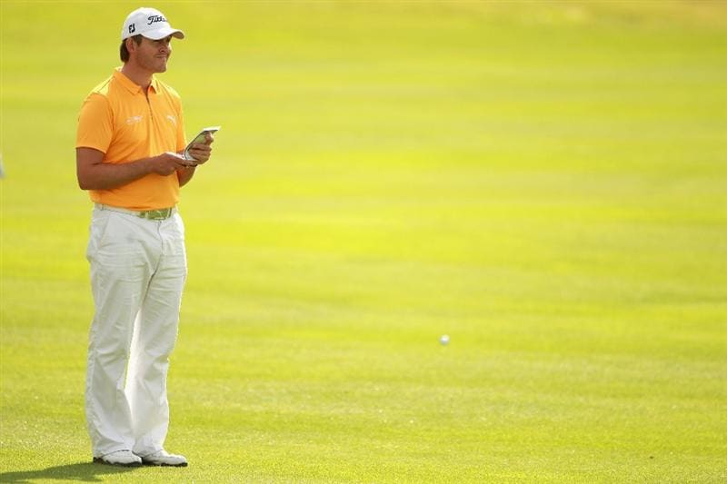 ESTORIL, PORTUGAL - JUNE 10:  Stuart Manley of Wales checks his yardage on the eighth hole during the first round of the Estoril Open de Portugal at Penha Longa Golf Club on June 10, 2010 in Estoril, Portugal.  (Photo by Warren Little/Getty Images)