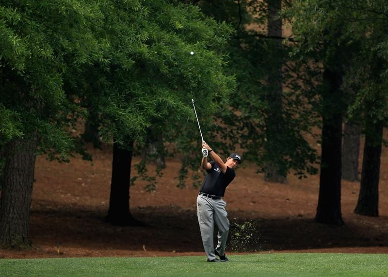 CHARLOTTE, NC - MAY 06:  Phil Mickelson hits a shot on the 3rd hole during the second round of the Wells Fargo Championship at Quail Hollow Club on May 6, 2011 in Charlotte, North Carolina.  (Photo by Streeter Lecka/Getty Images)