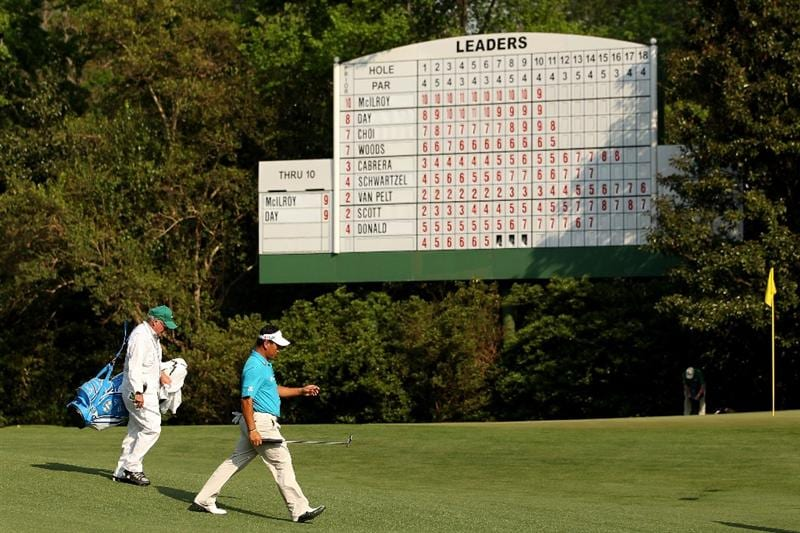 AUGUSTA, GA - APRIL 09:  K.J. Choi of South Korea walks to the 11th green with his caddie Andy Prodger during the third round of the 2011 Masters Tournament at Augusta National Golf Club on April 9, 2011 in Augusta, Georgia.  (Photo by Andrew Redington/Getty Images)