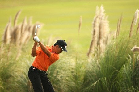 SHANGHAI, CHINA - NOVEMBER 08: Wen-chong Liang of China plays a hot on the 9th during Day 1 of the HSBC Champions at the Sheshan Golf Club on November 8, 2007 in Shanghai, China.  (Photo by Andrew Redington/Getty Images)