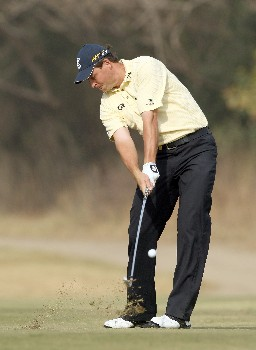DELHI, INDIA - FEBRUARY 07:  David Howell of England plays his second shot to the 10th hole during the first round of the Emaar-MGF Indian Masters at the Delhi Golf Club, on February 7, 2008 in Delhi, India.  (Photo by David Cannon/Getty Images)