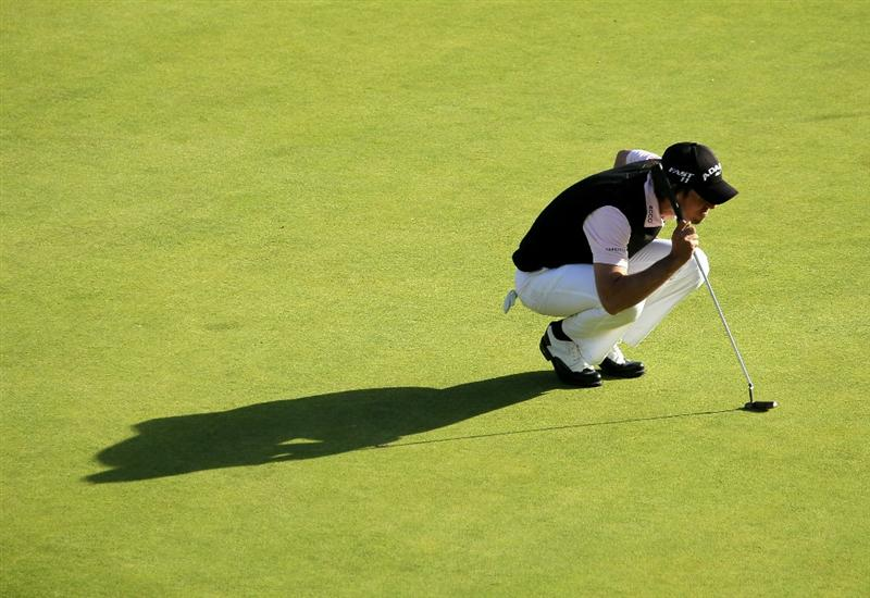 PACIFIC PALISADES, CA - FEBRUARY 20:  Aaron Baddeley of Australia lines up his final putt on the 18th green during the final round of the Northern Trust Open at Riviera Country Club on February 20, 2011 in Pacific Palisades, California.  (Photo by Stephen Dunn/Getty Images)