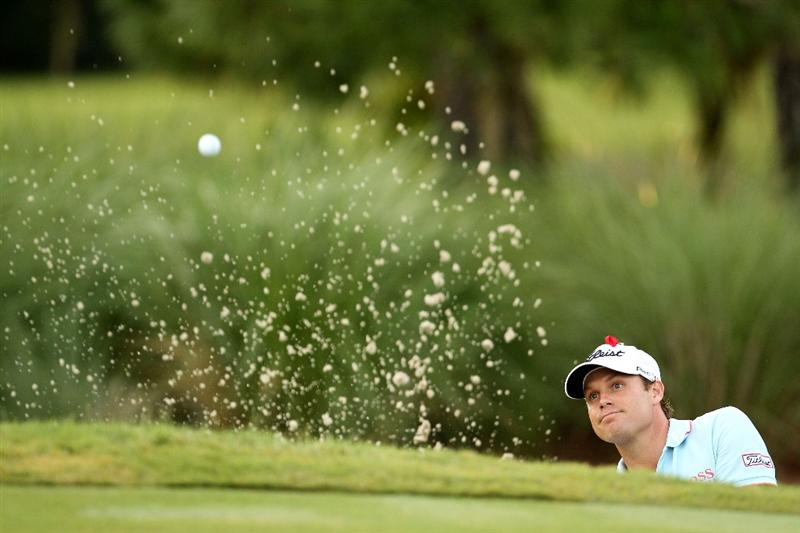 PONTE VEDRA BEACH, FL - MAY 14:  Nick Watney watches a bunker shot on the second hole during the third round of THE PLAYERS Championship held at THE PLAYERS Stadium course at TPC Sawgrass on May 14, 2011 in Ponte Vedra Beach, Florida.  (Photo by Mike Ehrmann/Getty Images)