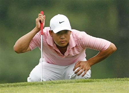 BETHESDA, MD - JULY 6: Anthony Kim lines up his birdie putt on the 15th hole during the final round of the AT&T National at Congressional Country Club on July 6, 2008 in Bethesda, Maryland. (Photo by Hunter Martin/Getty Images)